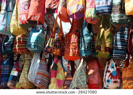A background with a view of ethnic bags in traditional Indian design, for sale.