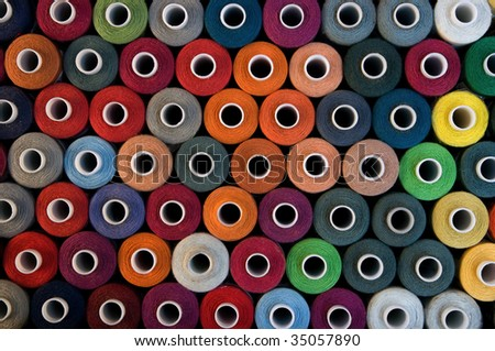 A background with bobbins display - stock photo