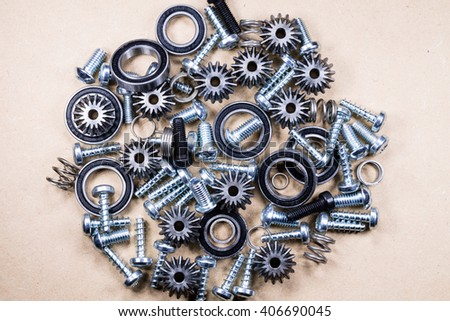A background with different mechanical components, gears, springs, screws, industrial objects. - stock photo