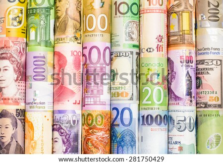 A backgrounds with colorful of many roll currency,money from many country - stock photo