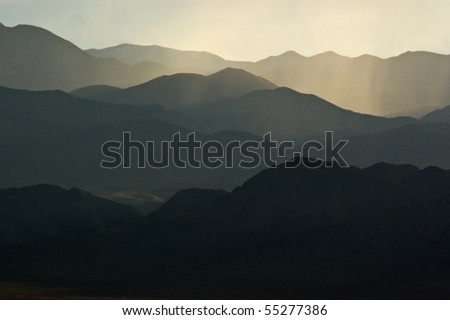 A backlit mountainscape in the desert of Death Valley Natoinal Park, California. - stock photo