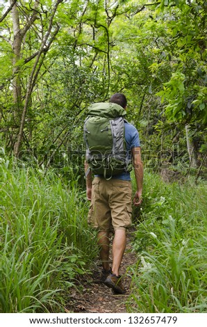 A backpacker on the trail. - stock photo