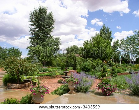 a backyard garden after a sudden thunderstorm - stock photo