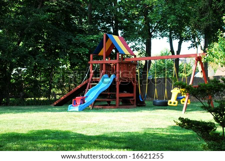A Backyard Jungle Gym Made Of Wood And With A Slide