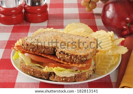 A bacon, lettuce and tomato sandwich on whole grain and seed bread