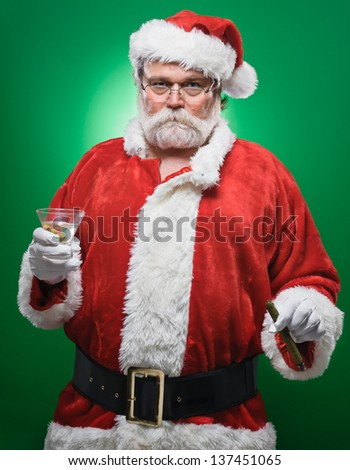 A bad Santa smoking a cigar and drinking a martini. - stock photo