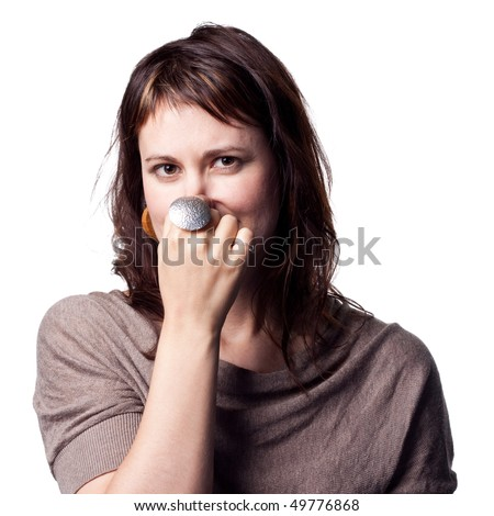 A bad smell makes this lady cover her nose - stock photo