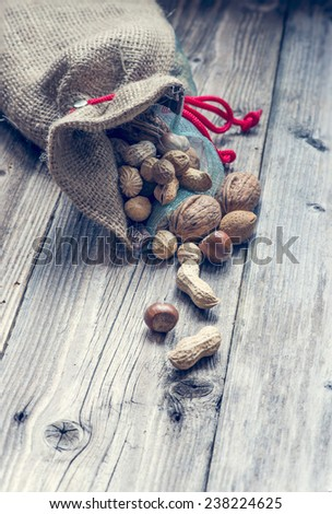 a bag full of nuts and almonds - stock photo