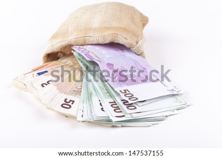 A bag full with euro banknotes pouring out isolated on white background - stock photo