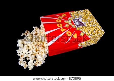 A bag of popcorn on a black background - stock photo