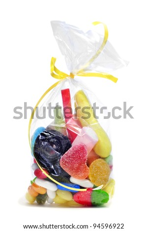 a bag with candies on a white background - stock photo