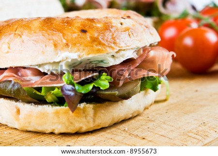 A bagel sandwich with tomatoes - stock photo