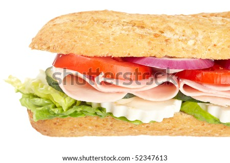 A baguette sandwich with ham, onion, lettuce, tomatoes and cheese. Shallow depth of field