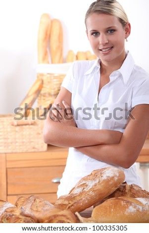 A baker posing with her bread - stock photo