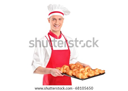 A baker with red apron holding croissants isolated on white background