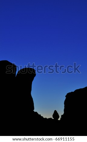 A balanced boulder in Arches National Park during the blue hour.