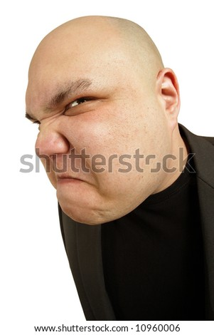 A bald man with an angry threatening sneer or disgusted look on his face. - stock photo