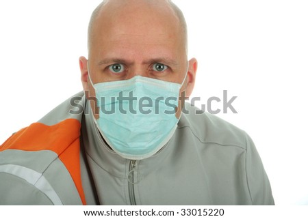 A bald man with facemask looking straigth at camera on white background with copy space - stock photo