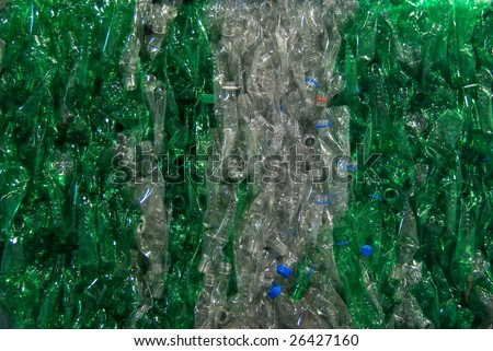 A bale a compressed plastic bottles. They are gathered per type and color. - stock photo