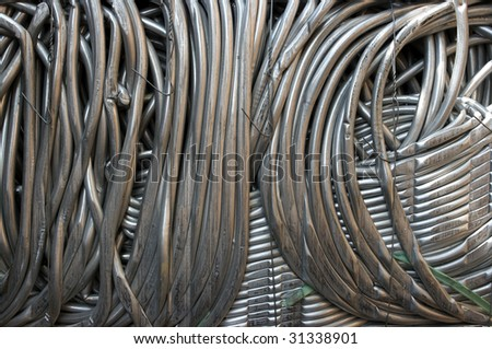 A bale of compressed aluminum tubes for recycling - stock photo