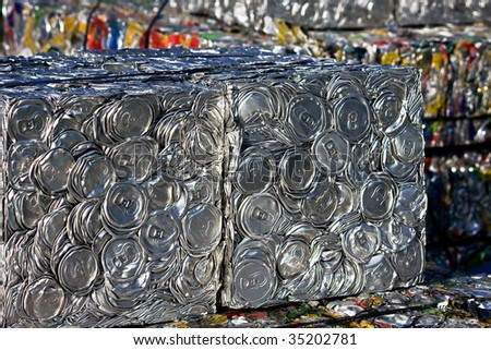 A bale of compressed tin cans for recycling