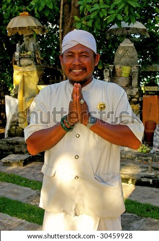 A Balinese man wearing traditional attire at a temple, Nusa Dua, Bali, Indonesia.