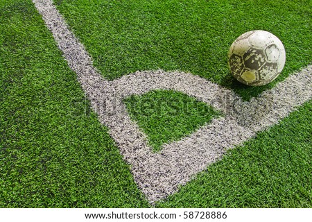 a ball at the corner of football field - stock photo