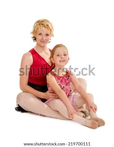 A Ballerina Dance Mom with Her Preschool Tiny Tot Dancer - stock photo