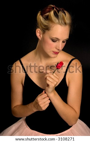 A ballerina with a red rose from audience.