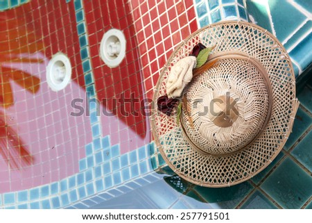 A bamboo hat at pool  - stock photo