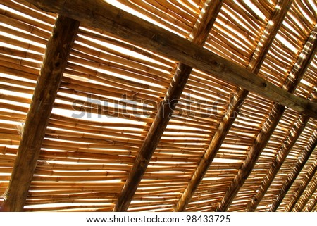 A bamboo roof against the sky.