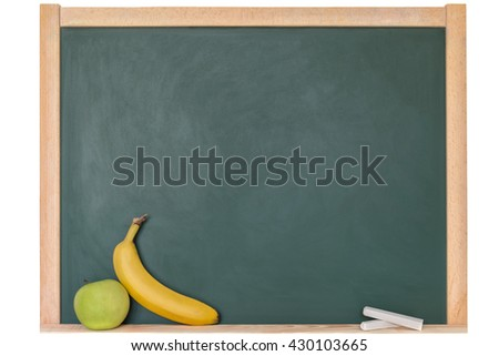 a banana and an apple in front of a blackboard - stock photo