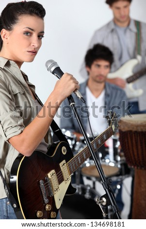 A band jamming together - stock photo