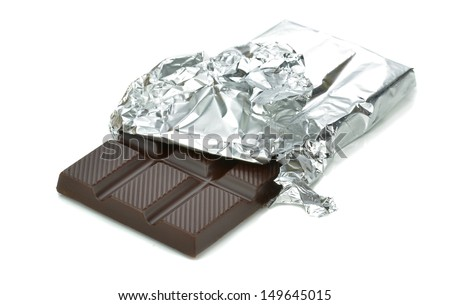 A bar of chocolate in tin foil wrapper on white background - stock photo