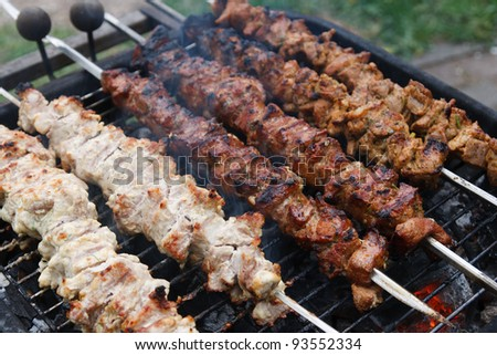 A barbecue meat slices prepare on fire