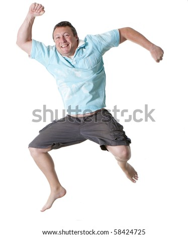 a barefoot middle-aged man jumping for joy