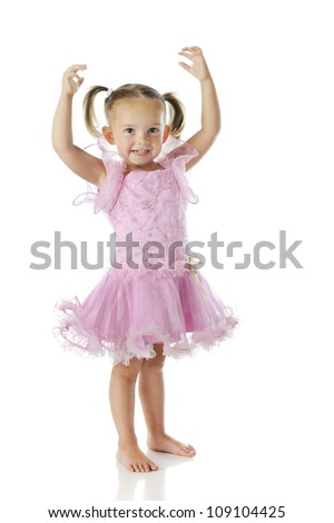 A barefoot preschooler wearing a pink ballerina dress with her arms arched over her head.  On a white background. - stock photo