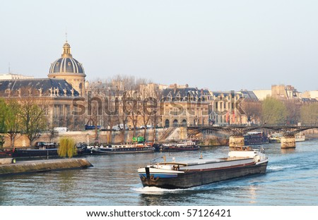A barge on the river Seine - stock photo