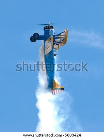 A barnstorming Stearman biplane flying vertically - stock photo