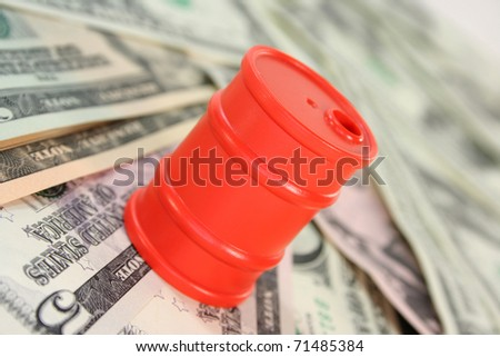 a barrel and dollar bills on a white background - stock photo