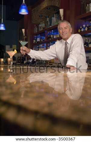 A bartender serves up 2 alcoholic drinks - stock photo