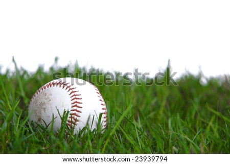 A baseball in the grass in studio