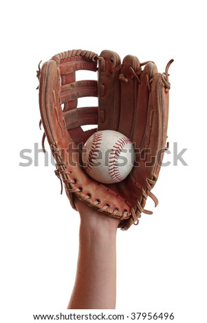 A baseball is caught in a worn baseball glove. - stock photo