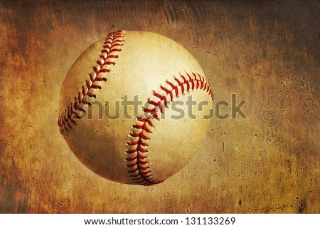 A baseball on a golden orange grunge textured background