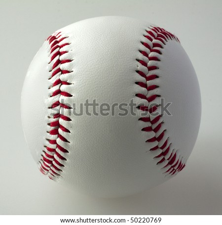 A baseball on a gray background