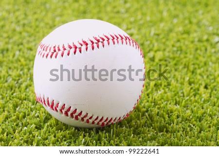A baseball over a green grass field - stock photo
