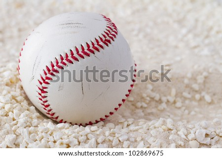 A baseball over a white sand background - stock photo
