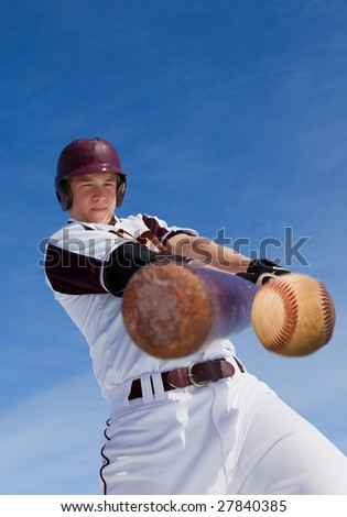 A baseball player taking a swing at a baseball