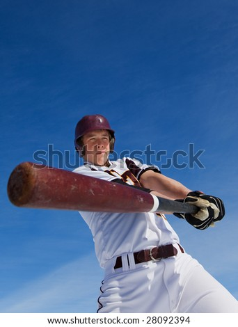 A baseball player taking a swing during spring training - stock photo