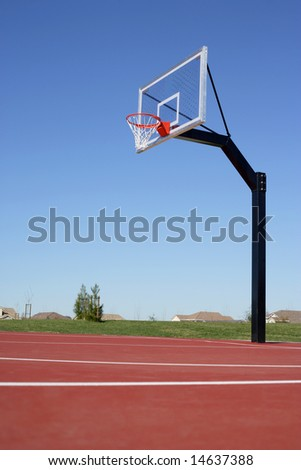 A basket ball hoop on an out door court - stock photo